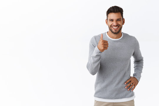 Good job, nicely done. Satisfied smiling handsome young male coworker give positive feedback, show thumb-up to express give praise and agreement, like amazing concept. white background