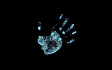 Close-up Of Handprint Against Black Background