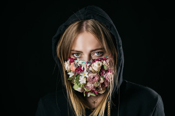 Beautiful girl with a mask of flowers Wall mural