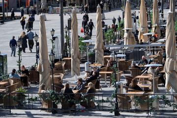 People enjoy the sunny weather on Easter Eve without following authorities advice to keep social distance amid the spread of the coronavirus disease (COVID-19) in Stockholm