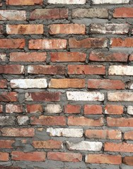 ragged red and white uneven brick wall