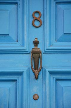 Old metal door handle of a wooden door