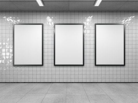 Three blank poster in public place. Vertical light box mockup on subway station. 3D rendering.