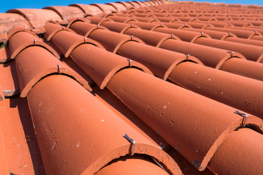 Close-up of roof tiles fixed by metal brackets, Galicia, Spain
