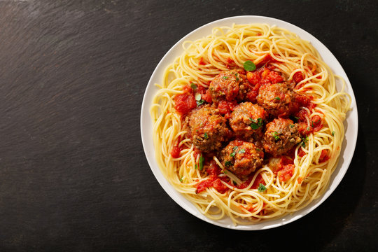 plate of pasta with meatballs, top view