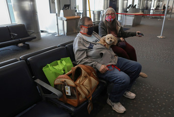 Harold Kimble and his wife Kandy Kimble travel with their dog Teddy Bear as they transport ashes of their son Phillip Casey in Denver
