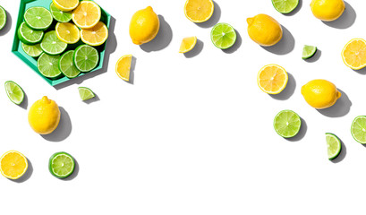 Wall Mural - Fresh lemons and limes overhead view - flat lay