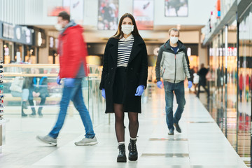 woman with face mask walking at public place. coronavirus outbreak