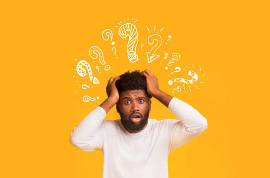 Shocked black guy with question mark over his head