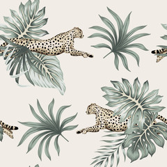 Vintage tropical palm leaves, cheetah running wildlife animal floral seamless pattern ivory background. Exotic jungle wallpaper.