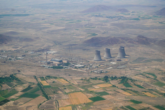 High Angle View Of Power Plant With Agricultural Fields Around