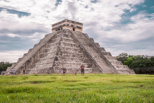 Temple Of Kukulcan At Chitchen Itza Against Cloudy Sky