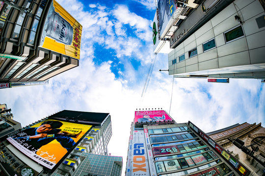 Low Angle View Of Advertisement On Buildings Against Sky