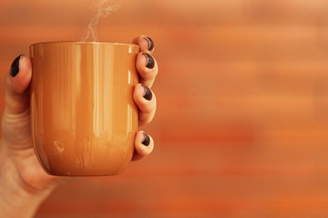 Cropped Image Of Hand Holding Coffee Cup