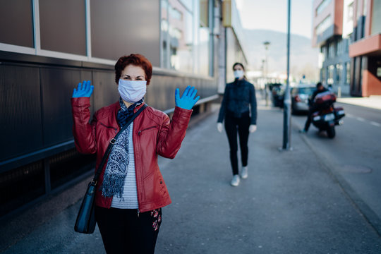 Senior elderly woman with protective cloth face mask and gloves..Coronavirus COVID-19 outbreak elder disease infection protection.Socializing restriction mental stress.Social distancing practice