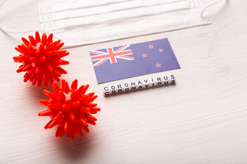 Abstract virus strain model of 2019-nCoV middle East respiratory syndrome coronavirus or coronavirus COVID-19 with text and flag New Zealand on white background. Virus pandemic protection concept.