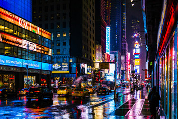Fotomurales - Illuminated City Street At Night
