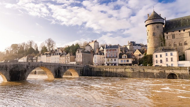 Laval, beautiful french city, panorama of the river and typical houses in the ancient center, downtown under the floods, the river in flood