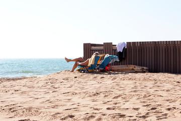 couple on deckchairs on beach