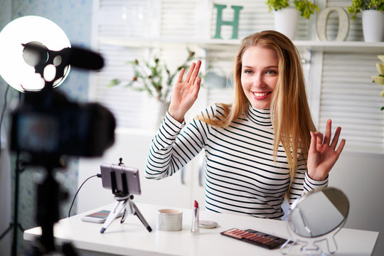Female beauty blogger showing ok sign with positive emotions. Influencer woman recommends quality of cosmetics in review. Make-up artist opinion leader advertising products to followers of her channel