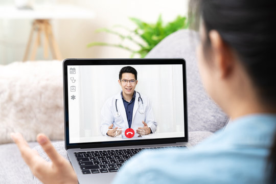 Telemedicine asian doctor video conference call online talking for follow up remotely with medical coronavirus result at home.Online healthcare digital technology service, counselor and interview app.
