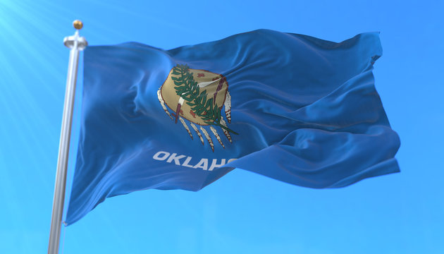 Flag of american state of Oklahoma, region of the United States, waving at wind