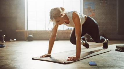 Beautiful and Young Girl Doing Running Plank Exercise on Her Fitness Mat. Athletic Woman Does...