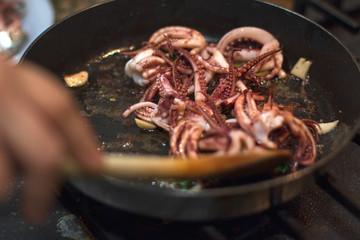 cooking calamari in frying pan