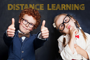 Happy kids and distance education concept. Smiling school girl and boy on blackboard background