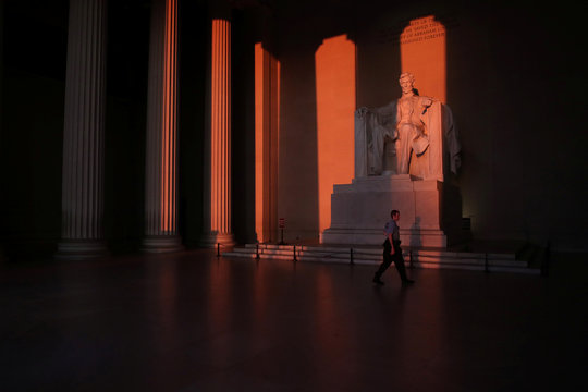 A U.S. Park Police officer patrols at the Lincoln Memorial during the coronavirus disease (COVID-19) outbreak, where normally thousands of Christians would gather for worship at Easter sunrise, in Washington