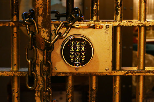 Close-up Of Combination Lock By Chain And Padlock On Gate