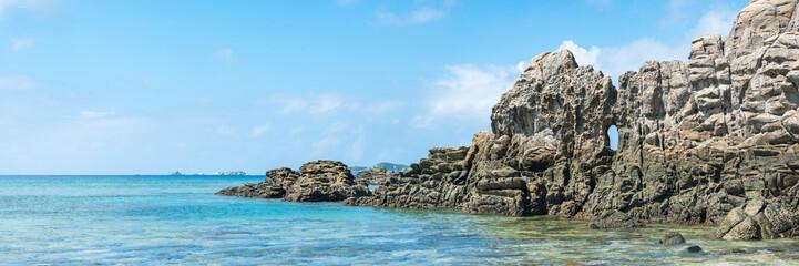 Wall Mural - Panoramic view of the rocky coast of Tokashiki island, Kerama Islands group, Okinawa, Japan