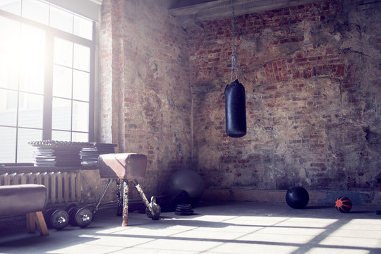 Gym with brick wall with sports equipment