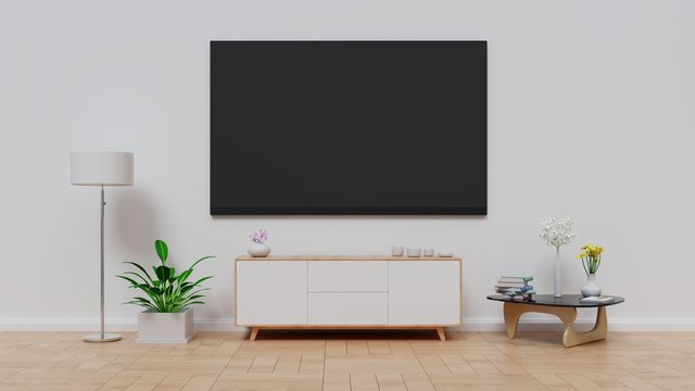 Television Set By Furniture Against Wall At Home