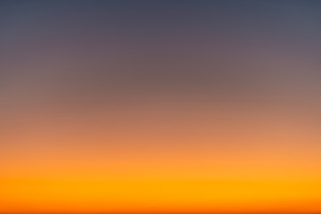 Canvas Prints Cappuccino Orange horizon and blue atmosphere. Smooth orange blue gradient of dawn sky.