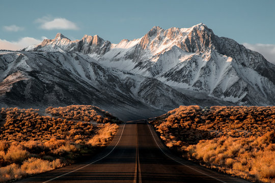 View of road leading towards snowy mountains