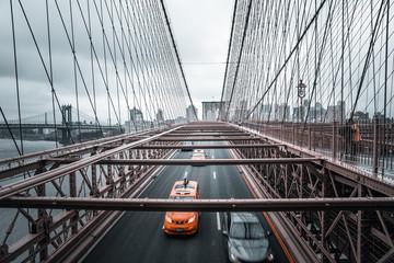 Wall Mural - Brooklyn Bridge traffic during rainy day.