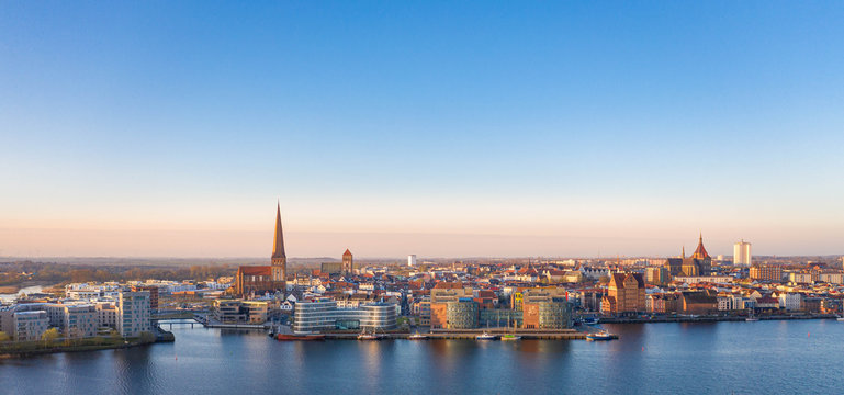 port of rostock at sunrise - view over the river warnow, skyline of rostock