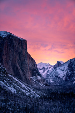 Dramatic sunset over snowy mountains in winter