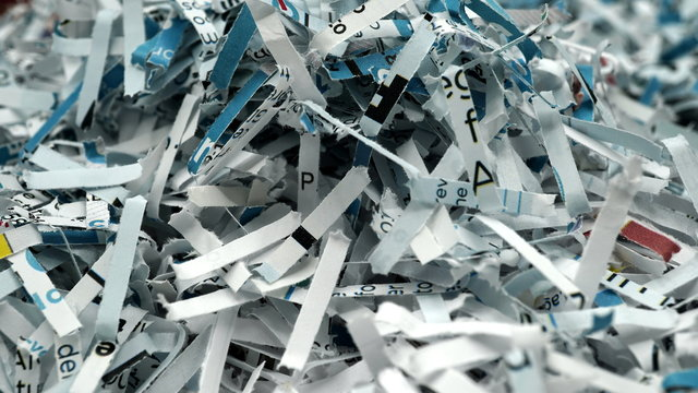 paper scraps of shredded documents seen in detail. Conceptual image for privacy, fake news