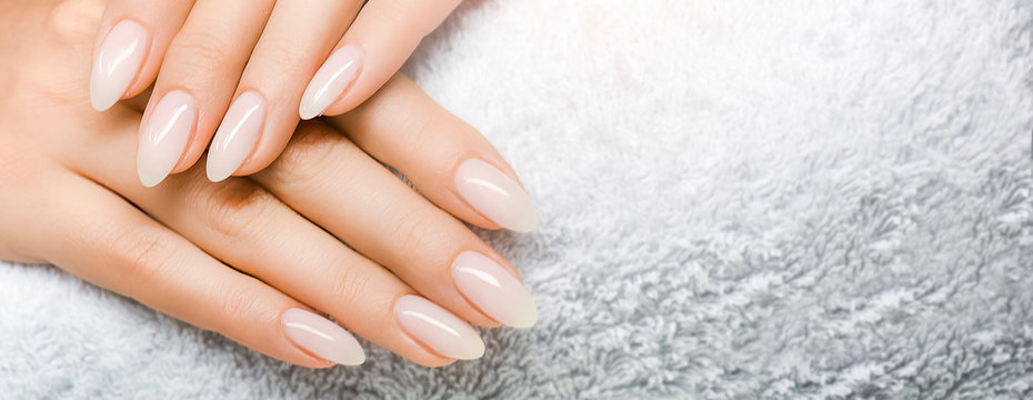 Manicured nails and Soft hands skin wide banner. Beauty treatment.