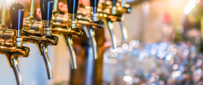 Beer tap selective focus wide banner.