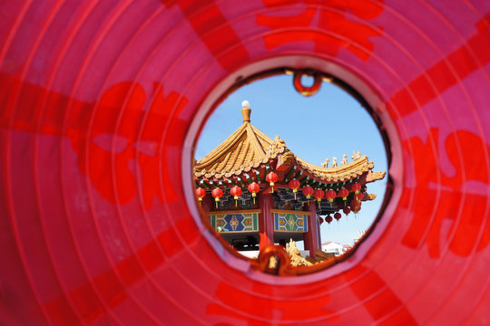 Temple Seen Through Red Lantern