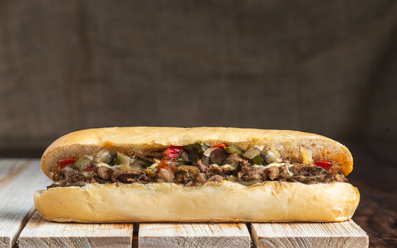 Philly cheese steak on wooden surface