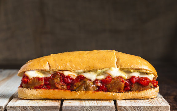 Meatball sub on wooden surface