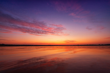 Printed kitchen splashbacks Eggplant Beautiful sunset on the lake with clouds and reflections on the water
