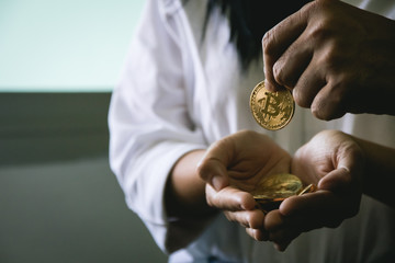Cropped Image Of Man Giving Coin To Woman