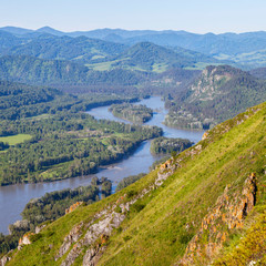 Fototapete - Tourism in Altay, Russia. View of the valley and the Katun River from the mountain. Spring view. Green forests and meadows and a beautiful sky.