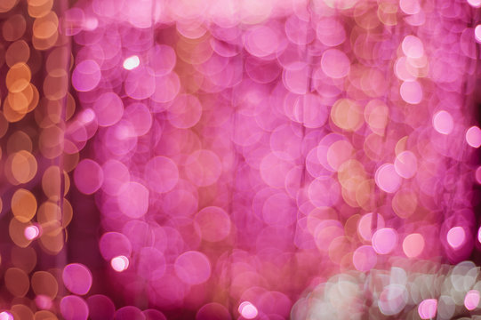 Defocused Image Of Pink Christmas Lights