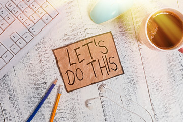 Writing note showing Let S Do This. Business concept for the act to agree on doing something or would like to do it Technological devices colored reminder paper office supplies